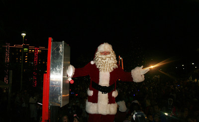 Santa flips the giant light switch to light up the Festival of Lights trail at the grand opening November 10 in Galveston, TX   (PRNewsFoto/Moody Gardens)