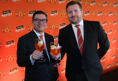 From L-R: Gruppo Campari Group CEO Bob Kunce-Concewitz, Manchester United Group Managing Director Richard ...
