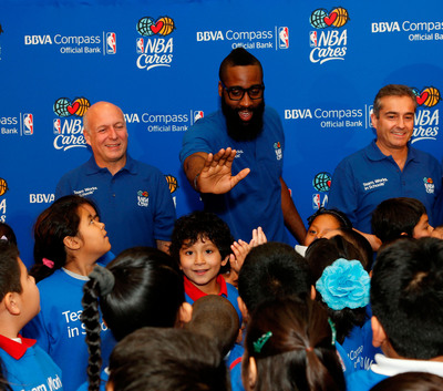 BBVA Compass President and CEO Manolo Sanchez, NBA All-Star James Harden, and BBVA Group President and COO Angel Cano came together to provide fitness, reading, and financial literacy to students at Benjamin Franklin Elementary in Houston, Texas.  (PRNewsFoto/BBVA Compass)
