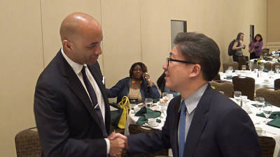 David Kim, CEO of C2 Education receives congratulations for winning the 2016 National Tutoring Association Program of the Year Award from the award luncheon's keynote speaker Byron Pitts, host of ABC-TV's Nightline.