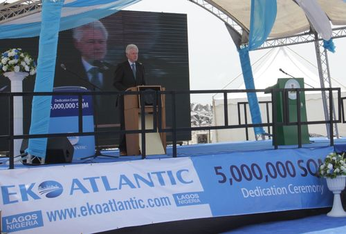 5,000,000 SQM Dedication Ceremony, Eko Atlantic, February 21, 2013. Former United States President Bill Clinton applauds the developers of Eko Atlantic City in Lagos, Nigeria. for reclaiming five million square meters of land and building The Great Wall of Lagos to protect the Lagos shoreline from rising sea levels and coastal erosion.