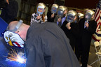 Sparks fly as the keel is authenticated for the U.S. Navy's future littoral combat ship USS Wichita (LCS 13). Ship sponsor Mrs. Kate Staples Lehrer had her initials welded into a sheet of the ship's steel on Feb. 9, 2015, in Marinette, Wisconsin. (Photo credit: Lockheed Martin)