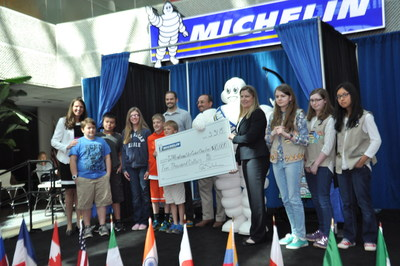 Michelin North America presents a check for $10,000 to Ellen Woodside Elementary and artist, Patricia Thomas, winners of the InTireNational Art contest held in Upstate, South Carolina.