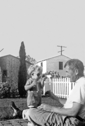 Nutrilite Health Institute President Sam Rehnborg as a child with his father and Nutrilite Founder Carl. F. ...
