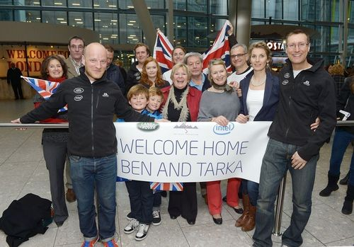 (L-R)Ben Saunders,Lucy Scott grandaughter of Captain Scott (second to left) with Tarka L'Herpiniere and friends of family as they are reunited with friends and family at Heathrow airport as they return to the UK having successfully completed the Scott Expedition supported by Intel and Land Rover on Tuesday, Feb. 18, 2014. (Photo by Jon Furniss/Invision for Intel/AP). (PRNewsFoto/Intel)