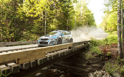 David Higgins and Craig Drew power through the Forests of Maine to win NEFR and the 2014 Rally America Championship. (PRNewsFoto/Subaru of America, Inc.)