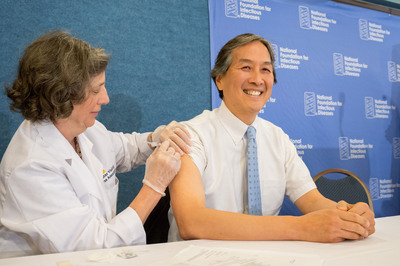 Howard K. Koh, M.D., Assistant Secretary for Health at the U.S. Department of Health and Human Services (HHS), Gets Flu Vaccine at a National Foundation for Infectious Diseases News Conference.  (PRNewsFoto/National Foundation for Infectious Diseases)
