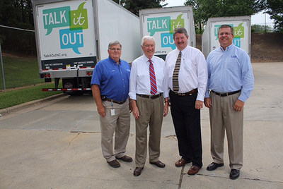 "New LB&B Trailers Promote North Carolina Commission ""Talk It Out"" Initiative. Pictured, left to right: Barry N. Lee, LB&B Project Manager; Robert A. Hamilton, Chief Administrator, North Carolina Alcoholic Beverage Control (NC-ABC) Commission; James C. Gardner, Chairman, NC-ABC Commission; Andy Woodlief, LB&B Fleet Manager. CAPTION: New LB&B trailers are appearing on North Carolina roads, not only transporting materials to various LB&B work sites around the state, but also encouraging the public to find out more about the North Carolina Alcoholic Beverage Control Commission's efforts to reduce underage drinking and encouraging parent-youth communication. For more information, visit the LB&B web site at lbbassociates.com."