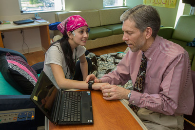 Epilepsy patient, Becca Sharpe, 16, is one of the patients currently enrolled in the Le Bonheur study. She's pictured with her epileptologist, Dr. James Wheless, co-director of the Neuroscience Institute at Le Bonheur Children's Hospital. (PRNewsFoto/Le Bonheur Children's Hospital) (PRNewsFoto/LE BONHEUR CHILDREN'S HOSPITAL)