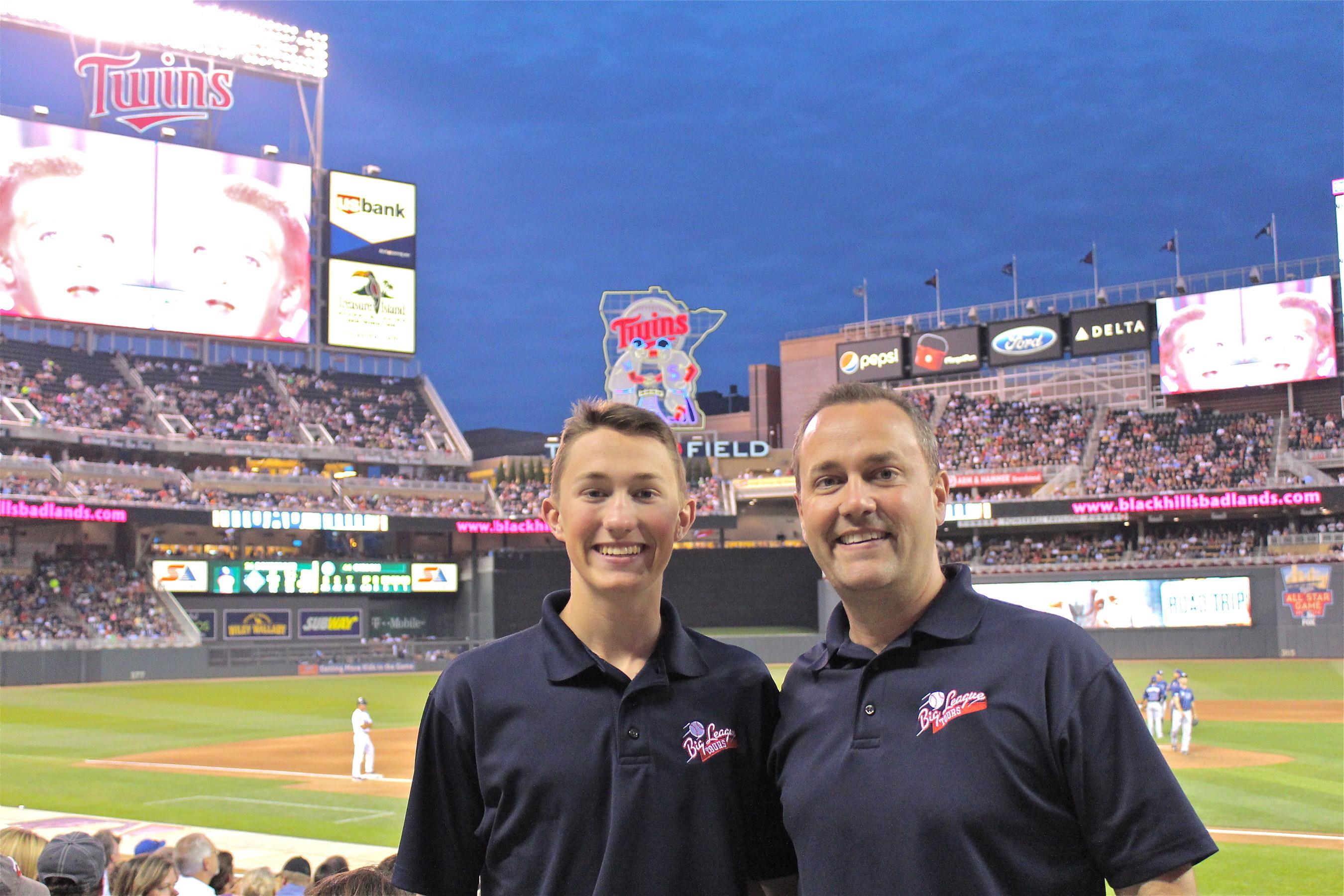 Glenn Dunlap and son, Hiatt share a moment together at Target Field celebrating their 30th baseball stadium.