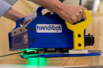 An innovative, portable power tool run from apps on smartphones, tablets or PCs. The Handibot smart tool brings push-button CNC technology to jobsites and DIY projects! 1. Work directly on tables, floors, ceilings and walls, wherever cutting, drilling, carving, or other machining is needed 2. Get the precision and power of robotics and digital control 3. Loaded with software apps for the jobs you need to do, Handibot goes to work with a squeeze of a button. Website:  www.handibot.com / ShopBot toll free: 888-680-4466.  (PRNewsFoto/ShopBot Tools, Inc.)