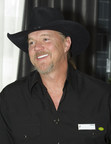 """Trace Adkins appeared at a Country Inns & Suites By Carlson hotel in Nashville to demonstrate the hotel's signature """"Be Our Guest"""" service philosophy on Thursday, Dec. 11, 2014 in Nashville, TN."""