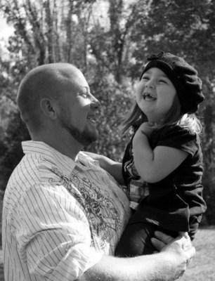 Aaron Riedel enjoying time with his daughter before his accident.