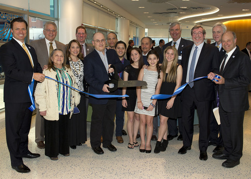 Alexandra and Steven Cohen, third and fourth from left, front, join representatives from Cohen Children's ...