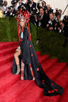 Sarah Jessica Parker, wearing a custom made H&M one-shouldered black silk dress, which she designed in collaboration with H&M, with a draped train embroidered with Scarlet poppies.