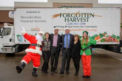 Santa was and his elf were joined by (from left to right):  Kathy Stott, Executive Director of Southwest Detroit Environmental Vision (SDEV); Kirk Mayes, CEO of Forgotten Harvest; Chris Trainor, Senior Manager of Controlling at Mercedes-Benz Financial Services, and a longtime Forgotten Harvest volunteer; and Debbie Swartz, Michigan Department of Environmental Quality (MDEQ) Office of Environmental Assistance.