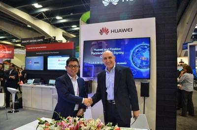 Liu Lizhu (Left), VP of Huawei Switch & Enterprise Communications Product Line, and Jim Lewandowski (Right), CEO of FireMon, are signing the MoU.