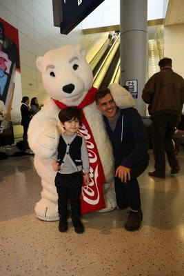 Dallas Fort Worth International Airport and Coca-Cola(R) Surprise Travelers with Holiday Cheer