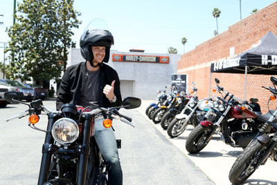 Actor Jesse Lee Soffer attends Harley-Davidson's pop-up motorcycle-share in Los Angeles to test out the new Roadster motorcycle. Harley-Davidson took the new agile, garage-built style bike to city streets with pop-up Motorcycle-Share events in Los Angeles, Portland and Milwaukee. To test ride a Roadster or any of the 2016 motorcycles, visit a Harley-Davidson authorized dealership or schedule a test ride online at www.H-D.com.