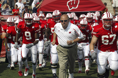 Madison, Wisconsin - 9/6/2003.  University of Wisconsin head coach Barry Alvarez leads his team onto the field before the Akron game at Camp Randall. Wisconsin beat Akron 48-31. (C)David Stluka.