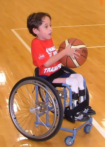 Kasey Yates, 7-year-old athlete is part of the wheelchair basketball team at Paralympic Sport Tampa Bay.  ...
