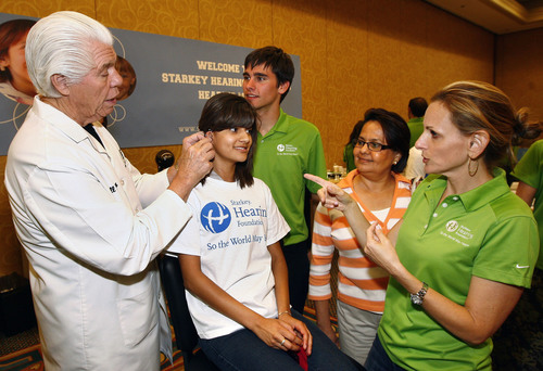 Bill Austin, Founder, Starkey Hearing Foundation (left), joined by actor Daniel Romer (center), and actress ...