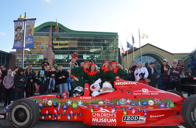 "A Dallara IndyCar delivered Santa to The Children's Museum of Indianapolis in record time! ""We certainly share Santa's sense of urgency in meeting with all the good little girls and boys this season and we are honored that he made it a priority to race in to The Children's Museum so early this year,"" said Dr. Jeffrey H. Patchen, president and CEO, The Children's Museum of Indianapolis. ""There is no where else I would rather be on the day after Thanksgiving!"""