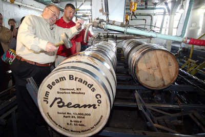 Fred Noe, Jim Beam's great-grandson and seventh generation master distiller for Jim Beam(R) Bourbon, hammers the bung into the company's historic 13 millionth barrel, filled April 23, 2014, in the cistern room on the grounds of the company's flagship distillery in Clermont, Ky. Noe was joined by his son, Freddie Noe, an eight generation Beam, who hammered in the final seal before the barrel was sent to age in the distillery's historic rackhouse D. (PRNewsFoto/Beam Inc.)