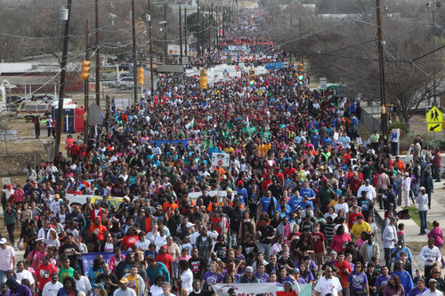 Each year more than 100,000 people participate in the City of San Antonio-sponsored march honoring the life and  ...