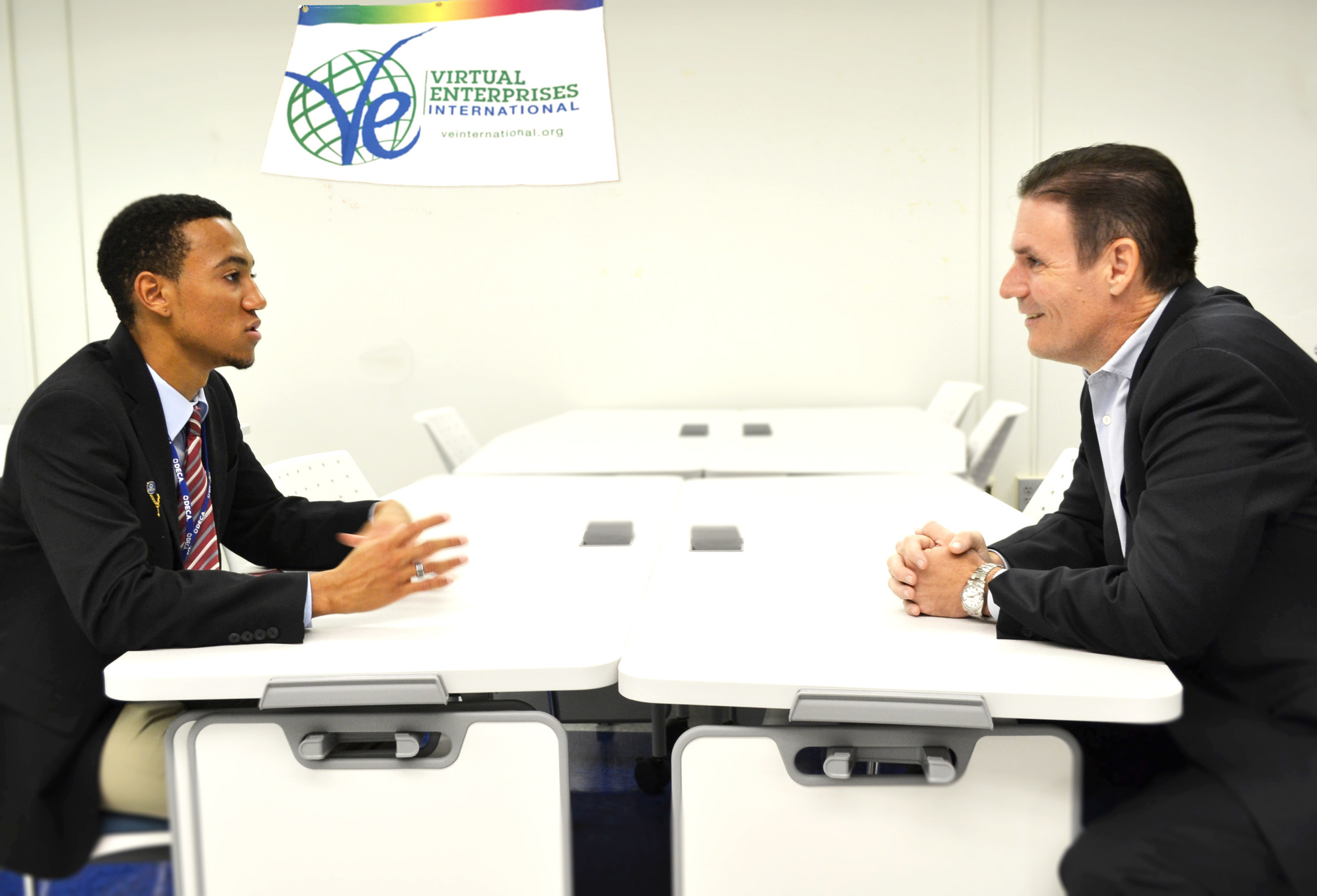 Digital Risk Co-founder & Managing Partner Jeff Taylor interviewing J.P. Taravella High School student Aaron Mitchell, newly elected CEO of the school's VEI program.