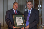 John Monaghan (right), a Fayetteville native and lifelong North Carolinian, was awarded North Carolina's Order of the Long Leaf Pine on October 1 at a celebration in Raleigh. The award certificate signed by Gov. Pat McCrory was presented by Monaghan's longtime friend, North Carolina State Sen. Brent Jackson (left).