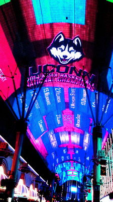 Fremont Street Experience celebrated the UConn Huskies triumphant NCAA Championship by displaying the team's name and logo in the winning slot on the world's largest NCAA Tournament bracket prominently displayed on the 1,500 foot-long Viva Vision canopy in downtown Las Vegas.  (PRNewsFoto/Fremont Street Experience)