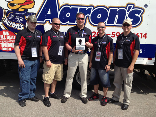 Members of the Wounded Warrior Project presented Aaron's with a commemorative plaque during a special ceremony at the Aaron's 312 Nationwide Series race at Talladega on Saturday. Pictured from L to R: Mitch Underwood - Marines, Monroe, MI; Andrew Coughlan - Army, Jacksonville, FL; Tom Peterson - Aaron's VP of Marketing; Chance Wade - Army, Amarillo, TX; James Rivera - Marines, Boonton, NJ.  (PRNewsFoto/Aaron's, Inc.)