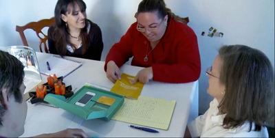 Antonieta Alvarez, a tanda owner in Mexico, tests a savings prototype developed by CGAP and IDEO.  (PRNewsFoto/CGAP)
