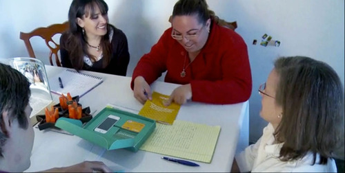 Antonieta Alvarez, a tanda owner in Mexico, tests a savings prototype developed by CGAP and IDEO.  ...