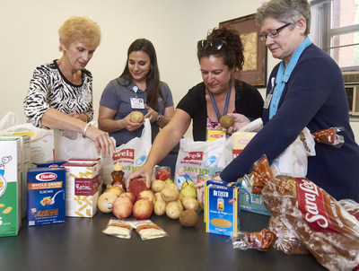 Volunteers with Geisinger Health System's Fresh Food Pharmacy pilot program fill weekly grocery bags with fresh produce, lean proteins and healthier sugars for the six participating diabetic patients. From left: Corinne Klose, Maria Welch, Michelle Weissinger and Helen Limbert.