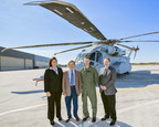 Representatives from Sikorsky, NATO JCGVL and the USMC stand in front of the CH-53K helicopter at Sikorsky's Florida Assembly Flight Operations Center (FAFO) in West Palm Beach, Florida. (Pictured from left to right) Caroline Vandedrinck (VP Europe & Central Asia, Sikorsky Aircraft), Hans-Peter Mueller (NATO JCGVL Committee Chairman), Lt. Col. John Ennis (CH-53K Government Flight Test Director), Mike Torok (VP CH-53K Program, Sikorsky Aircraft).