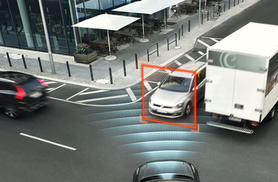 Intersection scenario - XC90 features automatic braking if the driver turns left (or right in left-hand traffic) in front of an oncoming car. The car detects a potential crash and brakes automatically in order to avoid a collision or mitigate the consequences.  (PRNewsFoto/Volvo Car Corporation)