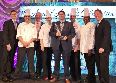 "Aramark accepts Nation's Restaurant News' MenuMasters award, in the category of Best Limited-Time Offer, for its Sports and Entertainment division's ""Stadium Sandwich"" series, in Chicago on May 16, 2015."