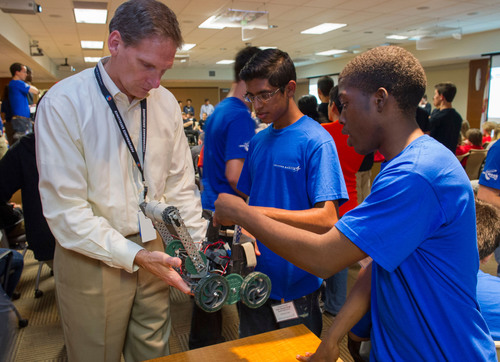 "Students at Apopka High School in Orlando, Fla., show off their ""Robario Kart"" design to Lockheed Martin mentor Jeff Pridmore, vice president and deputy of Technical Operations and Applied Research.  (PRNewsFoto/Lockheed Martin)"