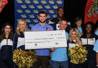 NFL player Andrew Luck presents Mission Middle School with $15,000 grant from Quaker to support wellness programs.