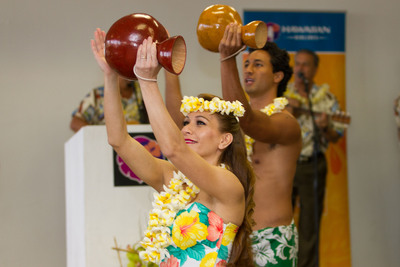 Guests of Hawaiian Airlines' inaugural flight today from Honolulu to Sapporo, Japan were treated to hula and Hawaiian music before boarding. Photo Credit: Anthony Consillio.  (PRNewsFoto/Hawaiian Airlines)