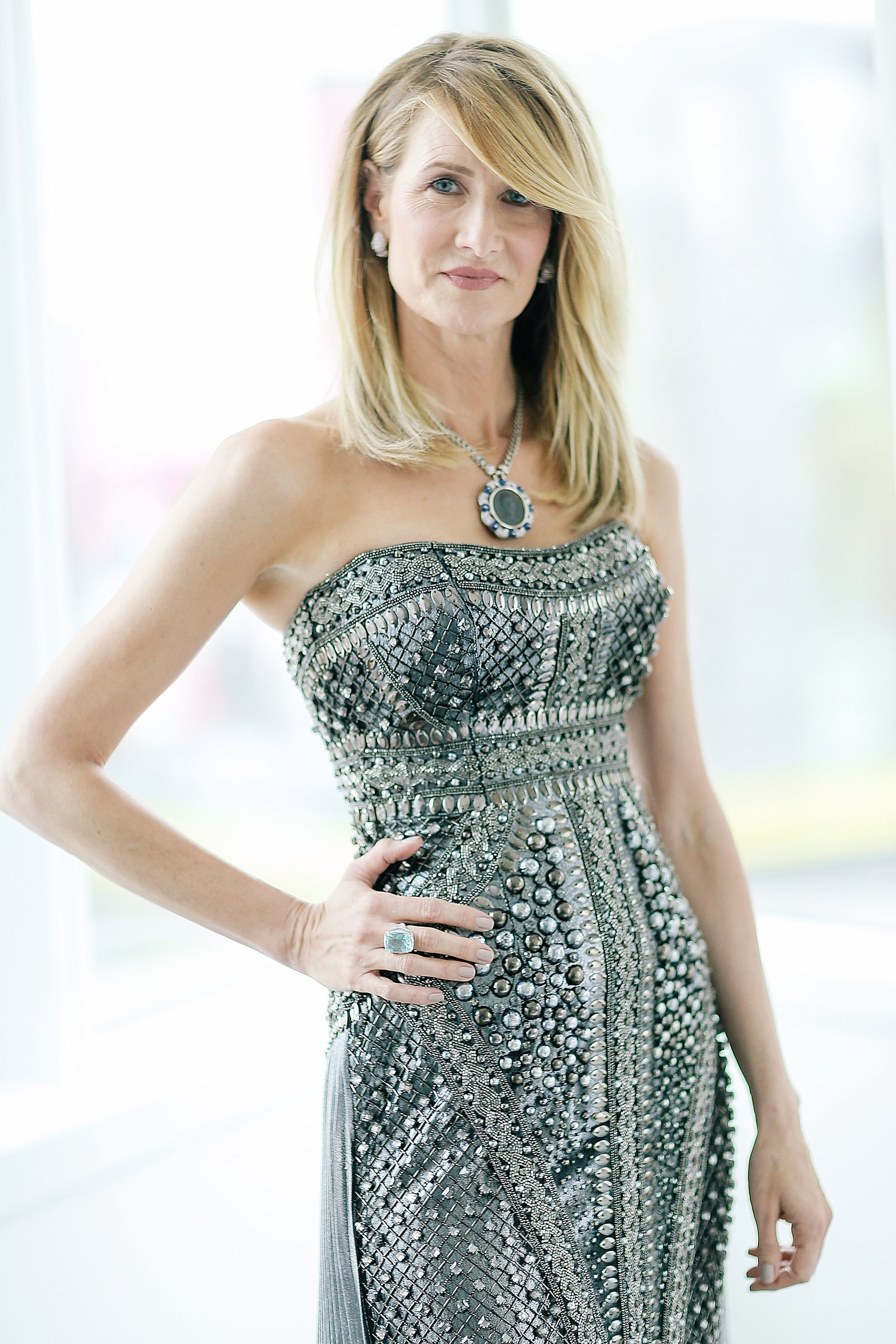 Best Supporting Actress nominee Laura Dern prepares for the Oscars(R) wearing a Bulgari turquoise ring in ...