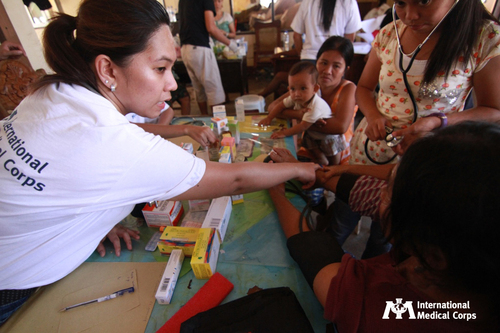 International Medical Corps providing critical medical services and medications in Hernani, Philippines ...