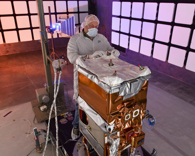 A Ball Aerospace engineer adjusts the multi-layer insulating blanket on NASA's Green Propellant Infusion Mission (GPIM) spacecraft bus.   The propulsion subsystem for GPIM has now been integrated. Performance and environmental testing are underway in Ball's electromagnetic interference (EMI) chamber to determine how well the satellite and its payloads can handle interference from other sources prior to being sent into space in 2016.