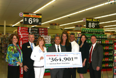 Pictured left to right: Cindy Stillman, Executive Director, Coachella Valley Chapter, American Heart Association, Dan Meyer, Executive Vice President - Retail Operations, Stater Bros. Markets, Susan Atkinson, President and CEO, Stater Bros. Charities, Steve Irigoyen, Featured Survivor, Agnes McGlone, Senior Account Manager, Corporate Relations, American Heart Association, Alfred Chavez, District Manager, Stater Bros. Markets, Kristie Woock, Senior Vice President Field Operations and Development, American Heart Association, and Keith Thomas, Regional Vice President, Stater Bros. Markets.  (PRNewsFoto/Stater Bros. Charities)