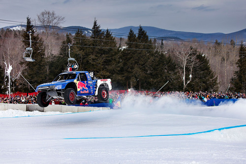 For the first time ever, eight professional off-road truck drivers raced head-to-head on snow for Red Bull Frozen Rush at Sunday River Ski Resort in Maine. Motorsports legend Ricky Johnson took first place in a close race that included multiple laps on a mile-long course with jumps, berms and slalom-style competition.  (PRNewsFoto/Red Bull)