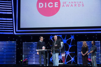 Aaryn Flynn and Mark Darrah of BioWare accept the Game of the Year award for Dragon Age: Inquisition, at the 18th Annual D.I.C.E. Awards presented by AIAS, Feb. 5, 2015.