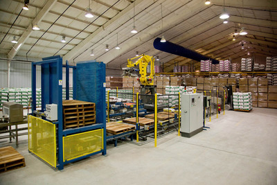 The new robot and enclosed production and climate controlled warehousing. Finished product is never exposed to ambient temperature nor outside air and loaded on to trucks with a sealed barrier.  (PRNewsFoto/Pinova, Inc.)