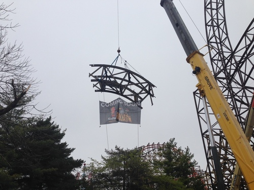 Six Flags Great America tops off world's tallest, steepest and fastest wooden roller coaster, Goliath. ...